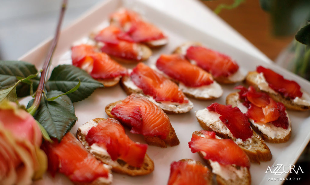A hrs d'oeurves platter of pacific northwest salmon beet red lox with caper cream cheese on house made rye bread crostini. Served at a winery wedding.